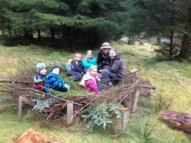 Kids having fun in a nest they built at Mull Eagle Watch